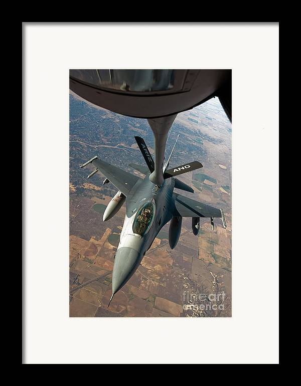 Air-to-air Framed Print featuring the photograph An F-16 Fighting Falcon Receiving Fuel by Stocktrek Images