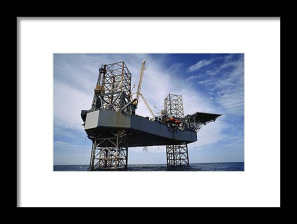 North America Framed Print featuring the photograph An Oil And Gas Drilling Platform by Justin Guariglia