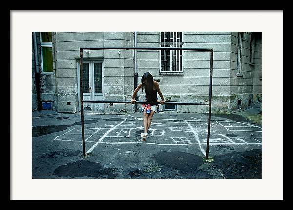 Children Framed Print featuring the photograph Ana At The Barre by Michael Ziegler