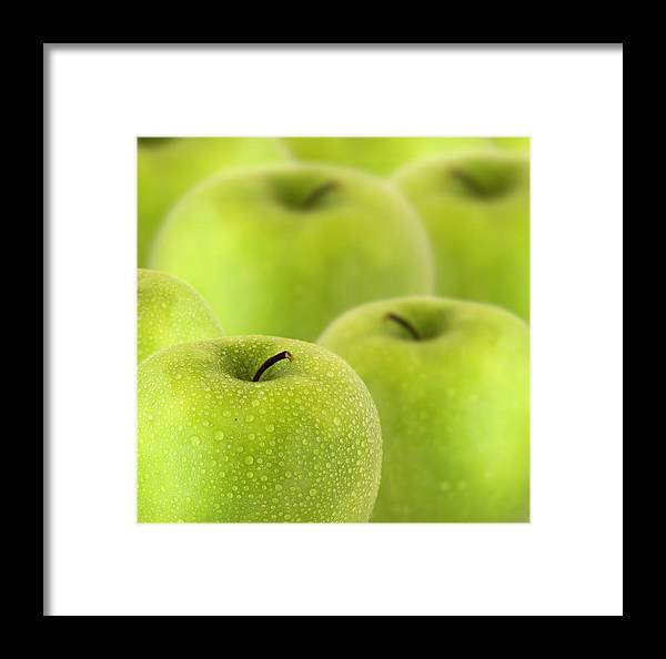 Apple Granny Smith Photographs Framed Print featuring the photograph Apples by D Plinth