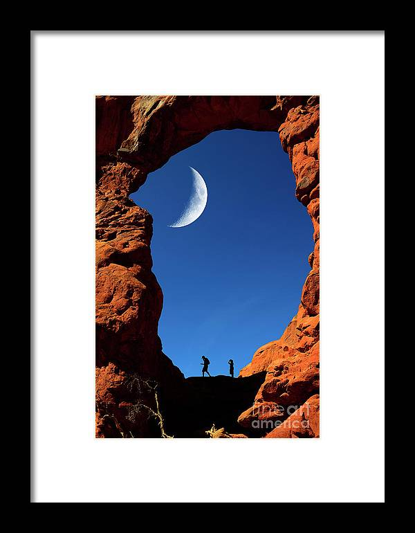 Adventure Framed Print featuring the photograph Arch In Canyon Rock Formations Silhouetter Of Hiker by Lane Erickson