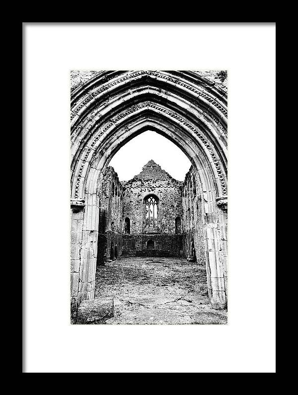 Athassel Framed Print featuring the photograph Athassel Priory Tipperary Ireland Medieval Ruins Decorative Arched Doorway Into Great Hall Bw by Shawn O'Brien