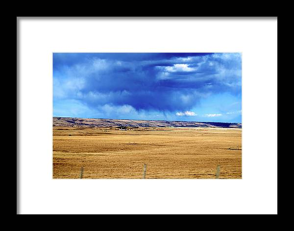 Plains Framed Print featuring the photograph Arising Storm Over Calgary by Andre Distel