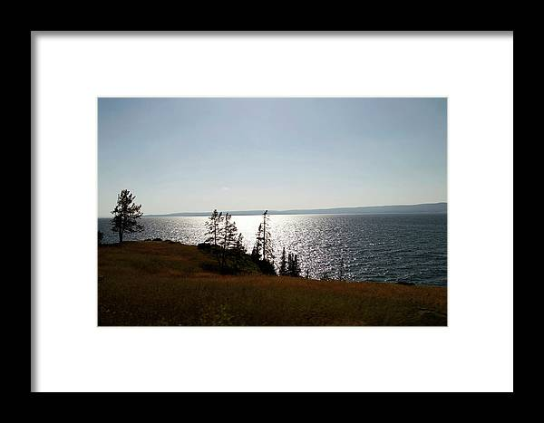 Yellowstone National Park Framed Print featuring the photograph August Evening At Yellowstone Lake by Thomas Woolworth