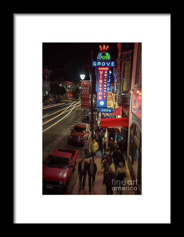 Grove Pharmacy Neon Sign Framed Print featuring the photograph Austin Fan Fest A Success As F1 Race Enthusiasts Pack 6th Street by Herronstock Prints