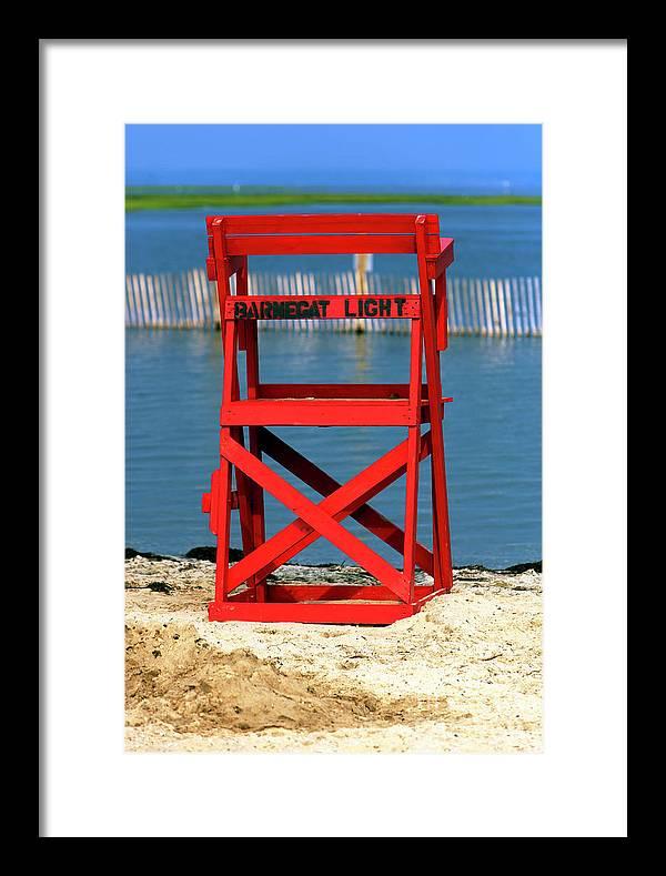 Barnegat Light Lifeguard Chair Framed Print featuring the photograph Barnegat Light Lifeguard Chair by John Rizzuto