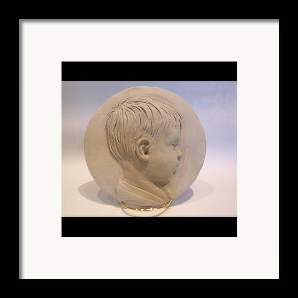 Bas Relief Of A Boy Framed Print featuring the relief Bas Relief Of Malek by Terri Meyer