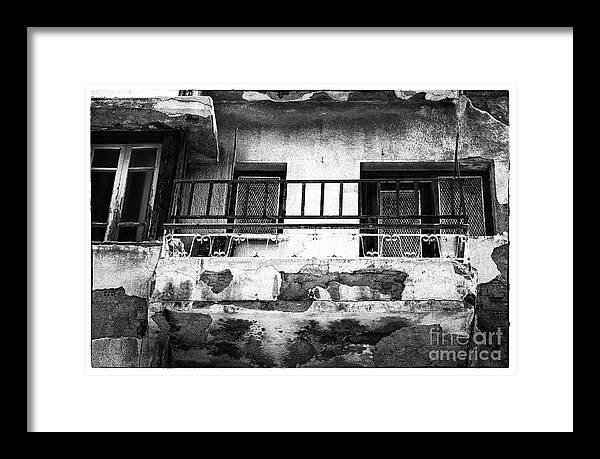 Battered Balcony Framed Print featuring the photograph Battered Balcony by John Rizzuto