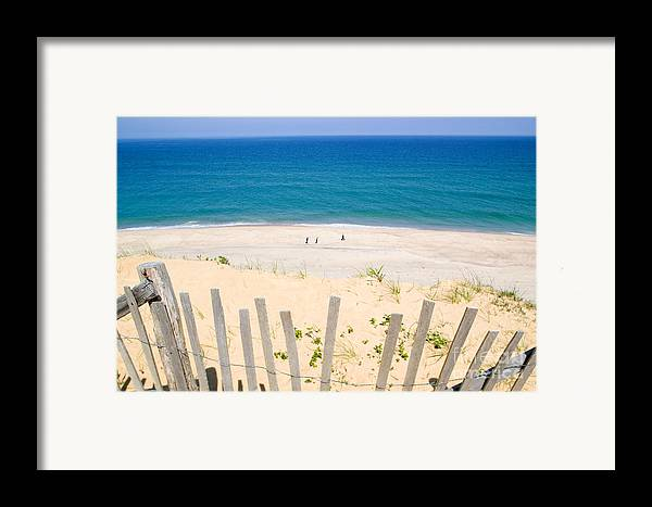 Beach Fence Framed Print featuring the photograph beach fence and ocean Cape Cod by Matt Suess