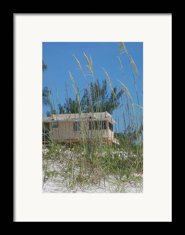 Landscape Framed Print featuring the photograph Beach House Through Sea Oats by Lisa Gabrius
