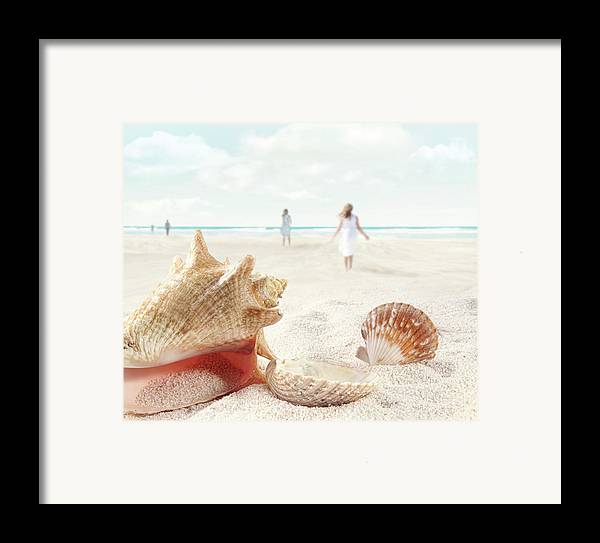 Aquatic Framed Print featuring the photograph Beach Scene With People Walking And Seashells by Sandra Cunningham