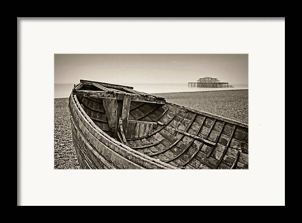 Britain Framed Print featuring the photograph Beached At Brighton In Sepia by Tony Grider
