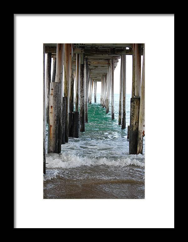 Under The Pier Photograph Framed Print featuring the photograph Below The Pier by Kristine McNamara