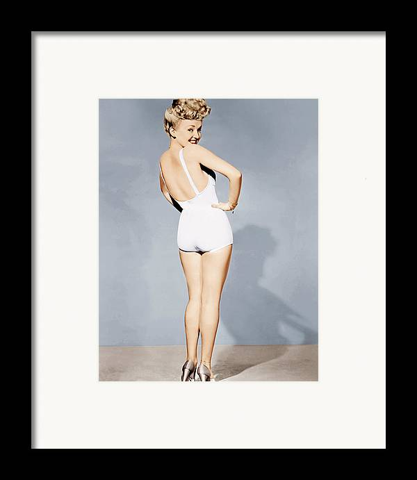 1940s Portraits Framed Print featuring the photograph Betty Grable, World War II Pin-up, 1943 by Everett