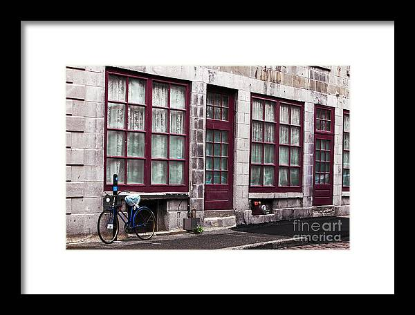 Bicycle In Old Montreal Framed Print featuring the photograph Bicycle In Old Montreal by John Rizzuto