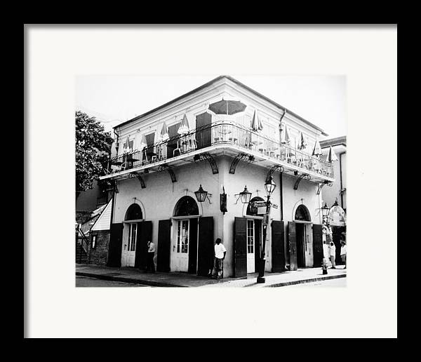 Travel Framed Print featuring the photograph Bienville And Bourbon Streets by Allan McConnell