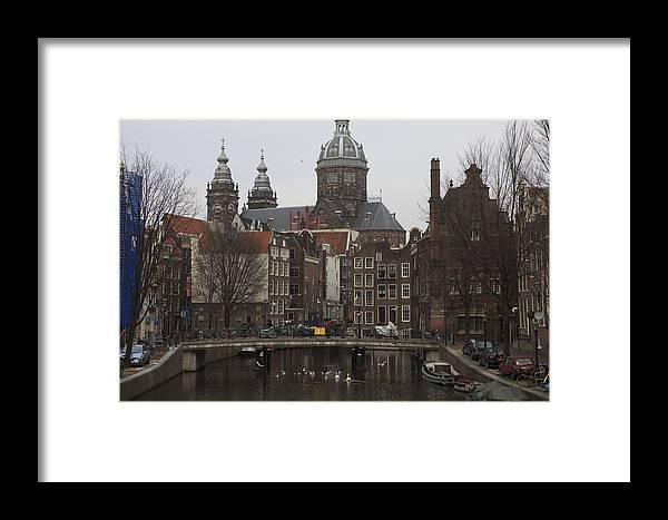 Amsterdam Canal Framed Print featuring the photograph Birds Under The Bridge by Alexander Davydov