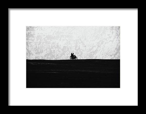 2 Framed Print featuring the photograph Black And White Capture Of Two People Riding On The Motorbike In The Distance by Srdjan Kirtic