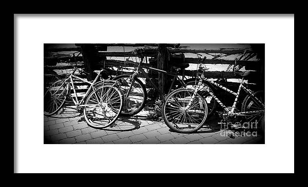 Bike Framed Print featuring the photograph Black And White Leaning Bikes by Emily Kelley