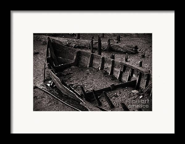 Abandon Framed Print featuring the photograph Boat Remains by Carlos Caetano