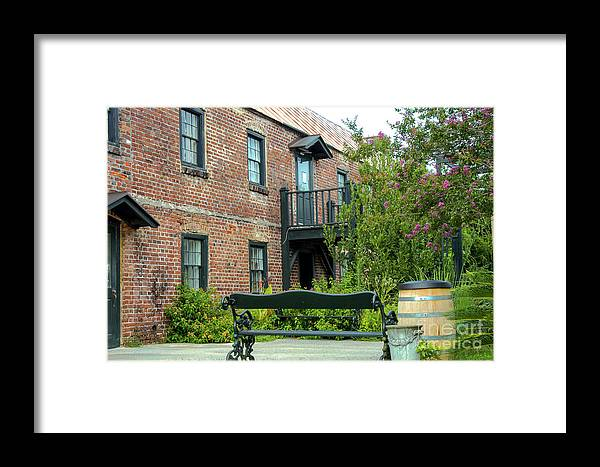 Boone Hall Plantation Mount Pleasant South Carolina Landmark Landmarks Cotton Gin Structure Structures Architecture Building Buildings Brick Bricks Trees Tree Door Doors Window Windows Bench Benches Barrel Barrels Landscape Landscapes Framed Print featuring the photograph Boone Hall Cotton Gin by Bob Phillips