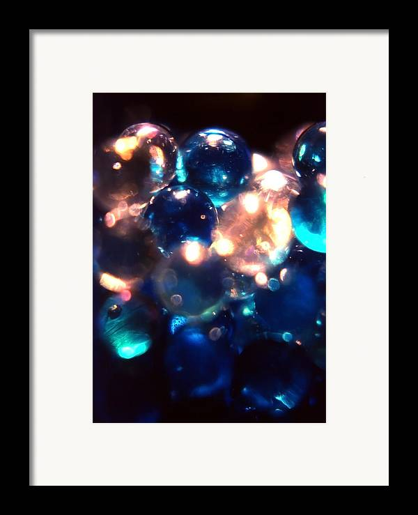 Marbles; Blue; White; Clear; Transparent; Bottle; Glass; Spotlight; Light; Refract; Abstract Framed Print featuring the photograph Bottled Marbles by Steve Ohlsen