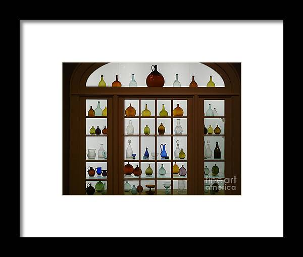 Photography Bottles Windows Still Life Framed Print featuring the photograph Bottles by Loretta Orr