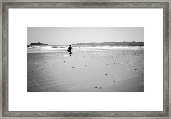 Beach framed print featuring the photograph boy on the beach portmarnock ireland black