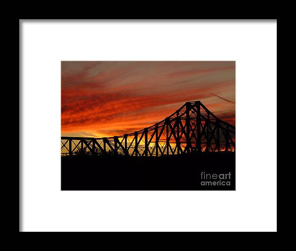 Photography Bridges Silhouette Sunset Landscape Framed Print featuring the photograph Bridge At Sunset by Loretta Orr