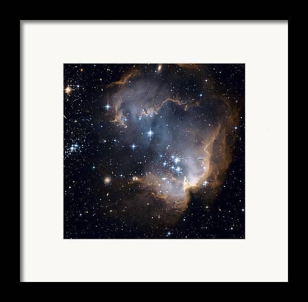 Galaxy Framed Print featuring the photograph Bright Blue Newborn Stars Blast A Hole by ESA and nASA