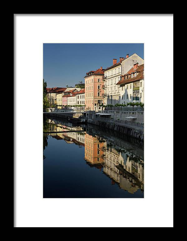 Bright Framed Print featuring the photograph Bright Buildings At The Ribja Brv Modern Footbridge Reflected In by Reimar Gaertner