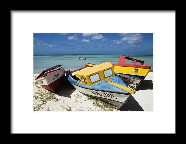 Antilles Framed Print featuring the photograph Brightly Painted Fishing Boats Aruba by George Oze