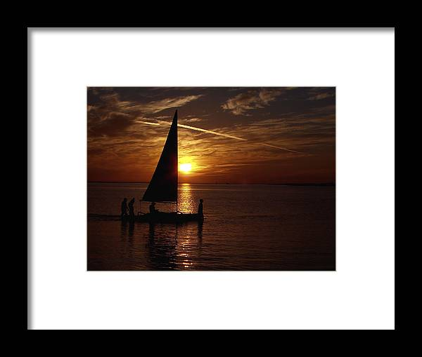 Waterscapes Framed Print featuring the photograph Bringing The Boat Home by Johann Todesengel