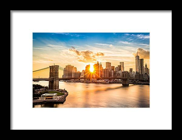 America Framed Print featuring the photograph Brooklyn Bridge and the Lower Manhattan skyline at sunset by Mihai Andritoiu