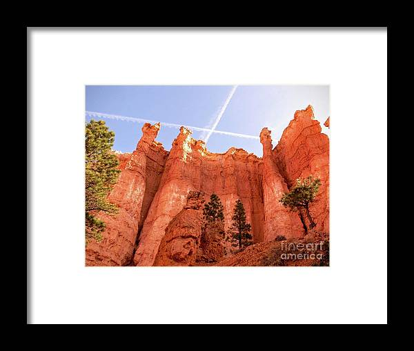 Bryce Canyon Framed Print featuring the photograph Bryce Canyon Hoodoos With Contrails by Rincon Road Photography By Ben Petersen