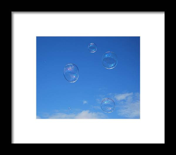 Bubbles Framed Print featuring the photograph Bubble Play by Marilynne Bull