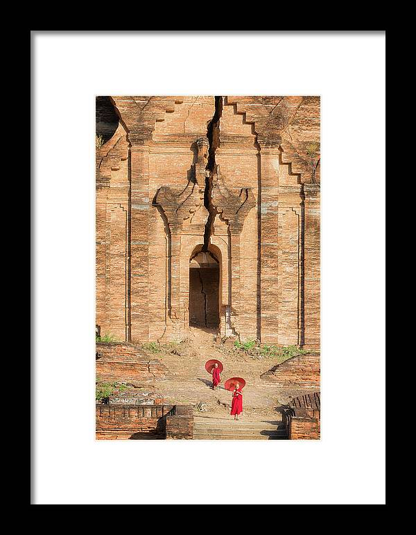 Mingun Framed Print featuring the photograph Buddhist Novice Are Walking In Temple by Anek Suwannaphoom