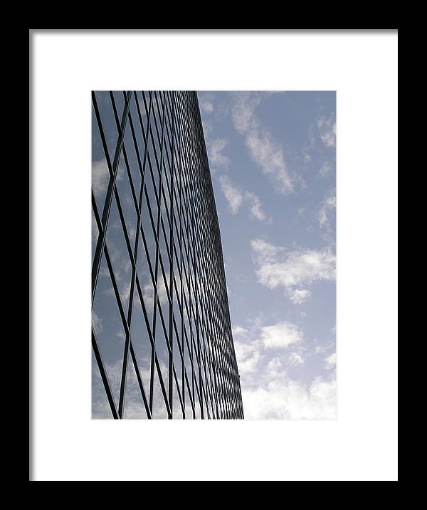 Glass Framed Print featuring the photograph Building And Cloudy Sky by Richard Mitchell