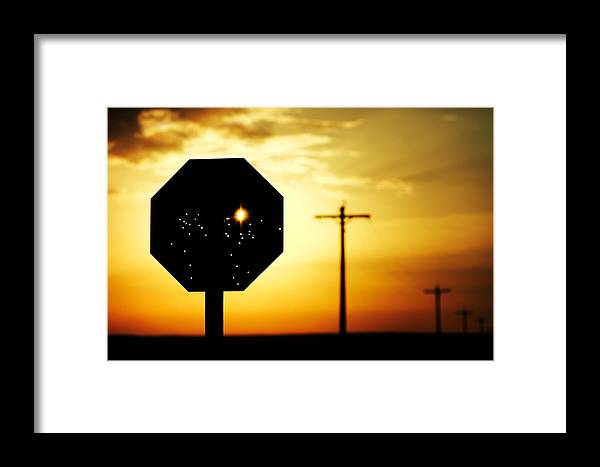 Stop Framed Print featuring the photograph Bullet-riddled Stop Sign by Todd Klassy