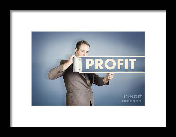 Financial Framed Print featuring the photograph Business Man Holding Financial Profit Street Sign by Jorgo Photography - Wall Art Gallery