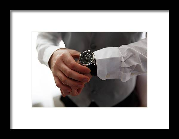 Background Framed Print featuring the photograph Businessman Looking At His Watch In Office by Jan Pavlovski
