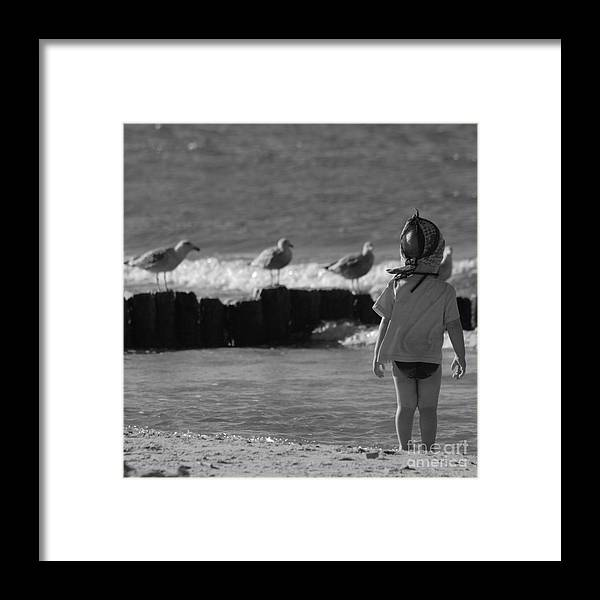 Child Framed Print featuring the photograph By The Sea by Angel Ciesniarska