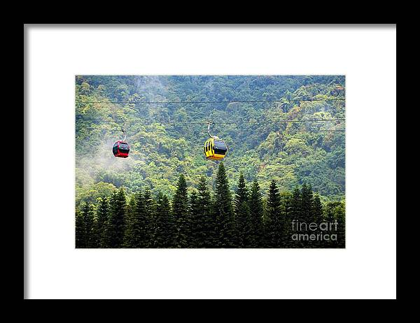 Cable-car Framed Print featuring the photograph Cable Car Passes By A Mountain Slope by Yali Shi