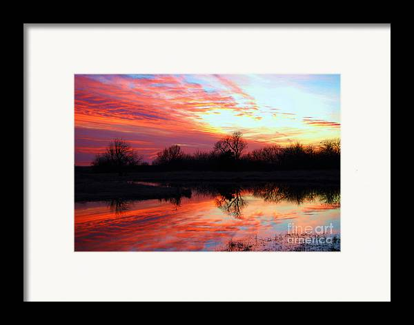 Clouds Framed Print featuring the photograph Calming Sunset by Larry Keahey