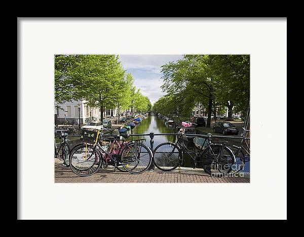 Amsterdam Framed Print featuring the photograph Canal Of Amsterdam by Joshua Francia