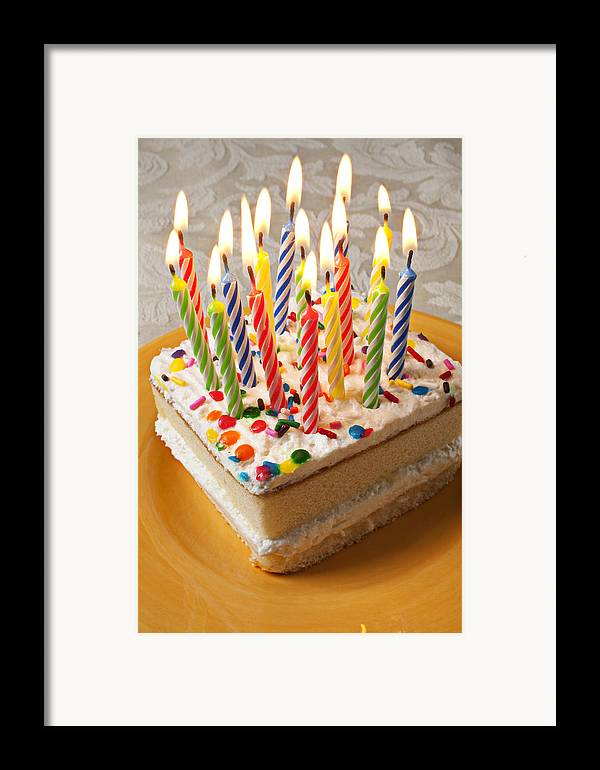 Flame Framed Print featuring the photograph Candles On Birthday Cake by Garry Gay