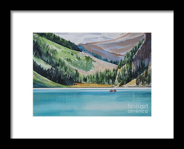 Canoe Framed Print featuring the painting Canoeing-in-lake-louise by Nancy Newman