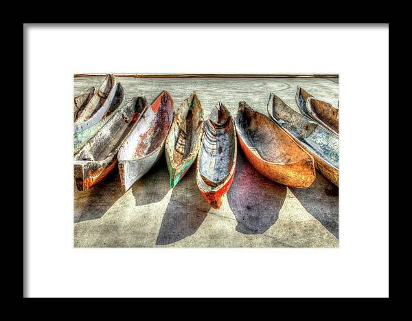 The Framed Print featuring the photograph Canoes by Debra and Dave Vanderlaan
