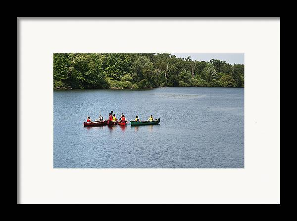 Canoe Framed Print featuring the photograph Canoes On Lake by Blink Images