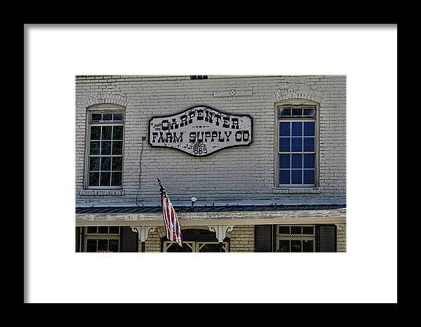 Historic Carpenter Farm Supply Framed Print featuring the photograph Carpenter Farm Supply Co Sign by Selena Wagner